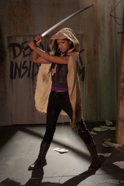 Skin Diamond AdultWebcamSites - Hot all natural tattoos pornstar Skin Diamond in sexy Michonne outfit with sword, vest top, black pants and biker boots - Skin Diamond as Michonne in The Walking Dead A Hardcore Parody Burning Angel Skin Diamond porn pics sfw - Walking Dead porn parody sfw pics