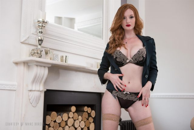 Zara DuRose AdultWebcamSites - Hot redhead British pornstar and fetish model Zara DuRose in sexy black blazer, tight black skirt, lacy black lingerie, stockings and suspenders with high heels and red lipstick - 41 Years Old The Cheating Spouse Marc Dorcel Dorcel Club Zara DuRose porn pics sfw