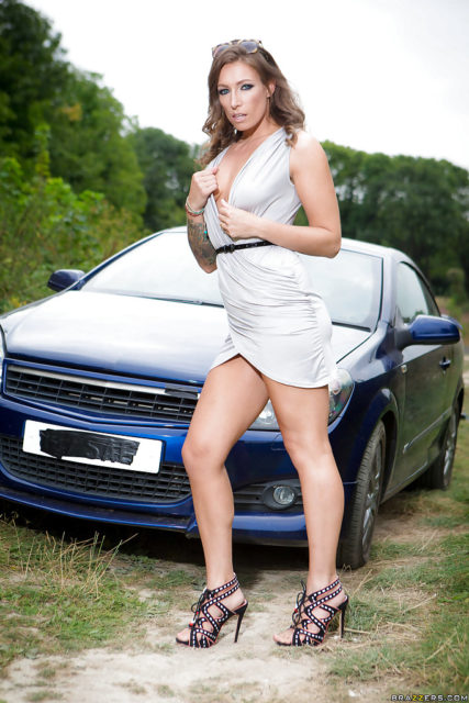 Ava Austen AdultWebcamSites - Hot busty brunette British pornstar with tattoos Ava Austen in sexy white dress with black belt and strappy black high heels that show off her cute toes, feet, legs and curves - Hitching For A Dicking Brazzers Ava Austen porn pics sfw