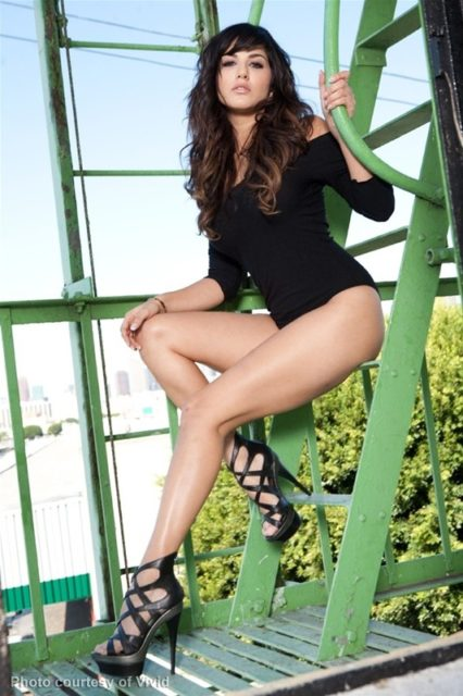Sunny Leone in black leotard and heels
