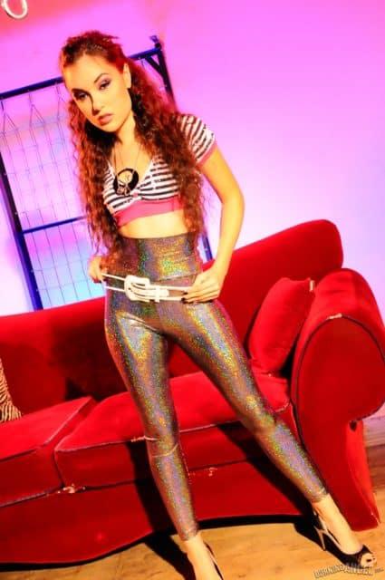 Sasha Grey in sparkly legging and crop top