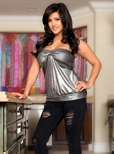 Sunny Leone in silver top and ripped jeans
