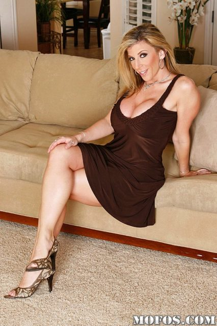 Sara Jay AdultWebcamSites - Hot busty blonde brunette MILF pornstar Sara Jay in sexy lowcut brown dress and strappy high heels that show off her cute feet, legs and natural curves - Mofos Sara Jay porn pics sfw