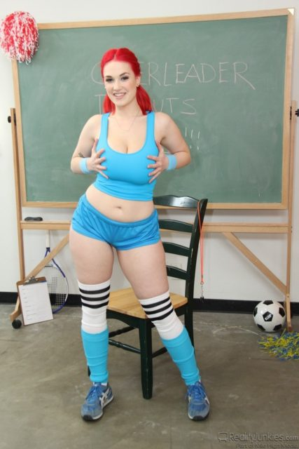 Siri AdultWebcamSites - Hot tall all natural busty pornstar Siri shows off her natural 32DDD big tits in a sexy blue top, blue booty shorts, blue and white knee high socks and blue sneakers with bright red hair - Big Tit Fantasies Reality Junkies Mile High Media Siri porn pics sfw
