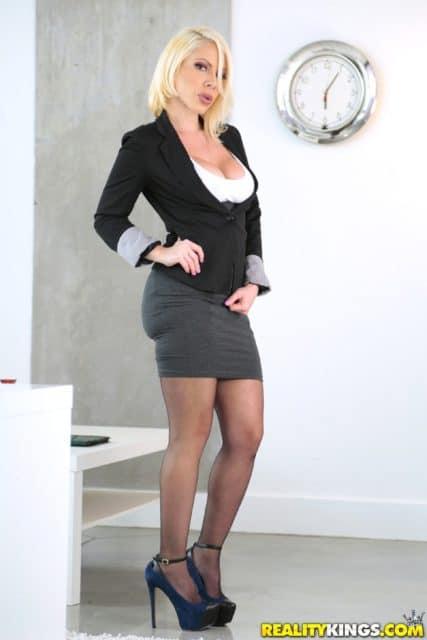 Dolce Vandela AdultWebcamSites - Busty blonde Czech MILF pornstar Dolce Vandela in sexy office wear with black blazer, white top, grey skirt, stockings and black high heels - Slide It In Sunny Reality Kings Dolce Vandela porn pics sfw