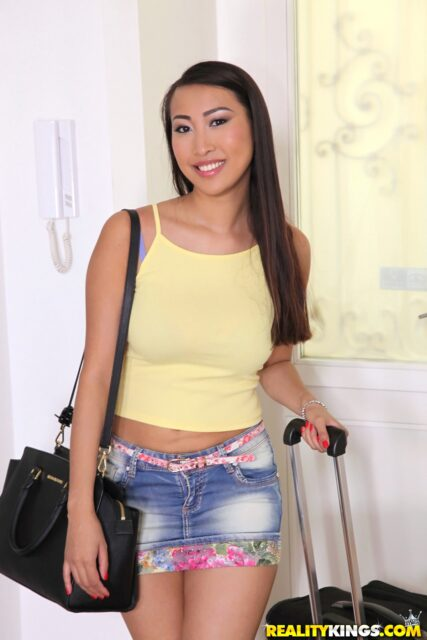 Sharon Lee AdultWebcamSites - Hot all natural French Asian pornstar Sharon Lee shows off her all natural big tits in sexy yellow vest top, denim mini skirt and high heels - Reality Kings Sharon Lee porn pics sfw