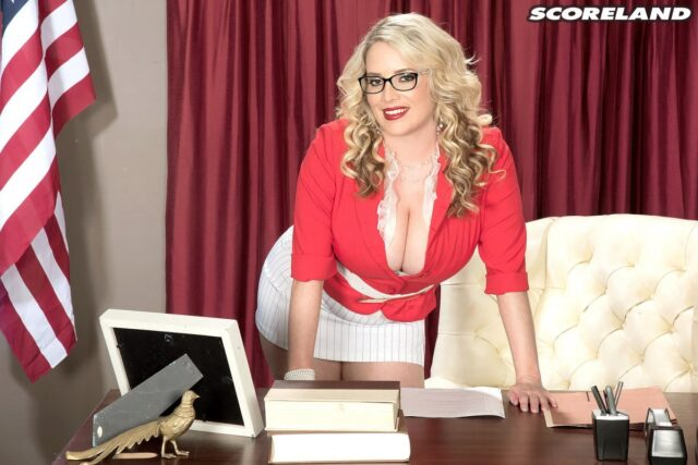 Maggie Green AdultWebcamSites - Hot all natural curvy MILF pornstar Maggie Green shows off her 34G big natural tits and big ass bubble butt booty in sexy black glasses, lowcut red top and skintight white skirt - Scoreland Maggie Green porn pics sfw