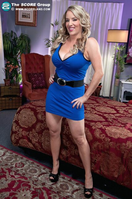 Maggie Green AdultWebcamSites - Hot all natural curvy MILF pornstar Maggie Green shows off her 34G big natural tits and big ass bubble butt booty in sexy blue dress, black belt and black peeptoe high heels that showcase her cute feet, toes, legs and all natural curves - Scoreland Maggie Green porn pics sfw