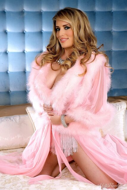Maggie Green AdultWebcamSites - Hot all natural curvy MILF pornstar Maggie Green shows off her 34G big natural tits and big ass bubble butt booty in sexy pink lingerie and pink fluffy robe negligee - Holly Randall Playboy Plus Maggie Green porn pics sfw