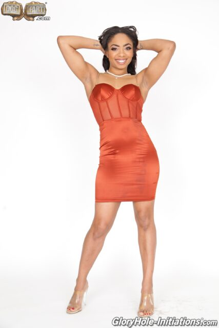 Cali Caliente XXXBios - Hot all natural petite black pornstar Cali Caliente in sexy red orange dress and high heels - GloryHole Initiations Dogfart Network Cali Caliente porn pics sfw