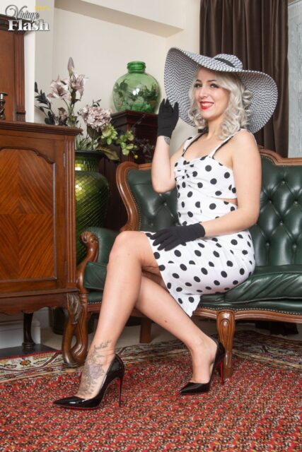 Liz Rainbow XXXBios - Hot blonde all natural tall Spanish pornstar Liz Rainbow in sexy black lingerie stockings and suspenders with red high heels and black and white polkadot dress with black hat - Liz Rainbow porn pics sfw