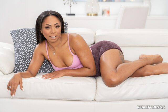 Cali Caliente XXXBios - Hot all natural petite black pornstar Cali Caliente in sexy pink bra top and purple booty shorts with barefeet - Sleeping Bag Shenanigans Reality Kings Cali Caliente porn pics sfw