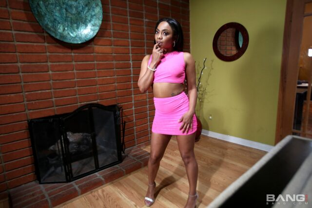 Cali Caliente XXXBios - Hot all natural petite black pornstar Cali Caliente in sexy cropped pink top and pink skirt with high heels - Bang.com Bang Fck News Cali Caliente porn pics sfw