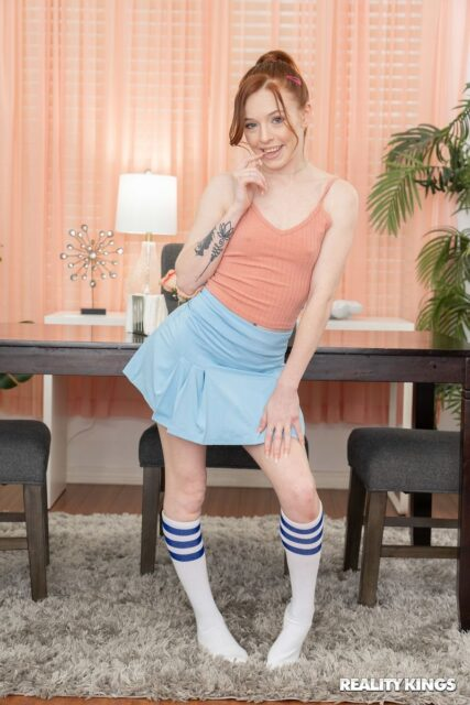 Madi Collins XXXBios - Hot all natural petite redhead teen pornstar Madi Collins in sexy pink vest top, blue mini skirt, lacy lingerie, white knee high socks and sneakers - Reality Kings Madi Collins porn pics sfw
